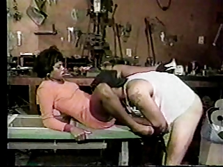 Black couple fucking in a garage shop!
