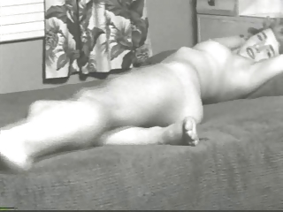 1950s  Blonde Gal Stips & Poses On Bed