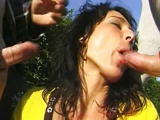 Double penetration MILF outdoors.