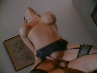Classic busty milf office fuck in stockings.